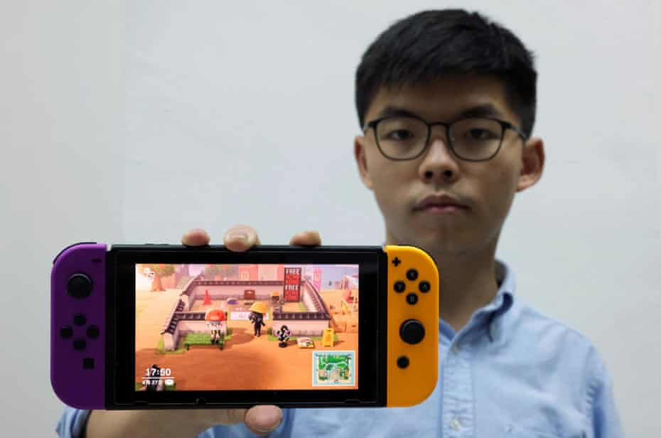 Pro-democracy activist Joshua Wong poses with the game Animal Crossing on Nintendo Switch in Hong Kong.