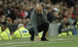 Pep Guardiola doesn't look happy either.