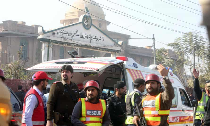 Security forces and rescuers outside Peshawar Agricultural Training Institute