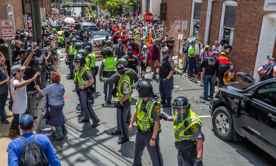 Police stand between white supremacists and anti-fascist protesters in Charlottesville.