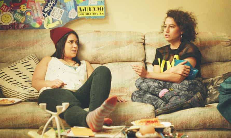 Abbi and Ilana from comedy Broad City, relaxing at home with pizza. Social media gold.