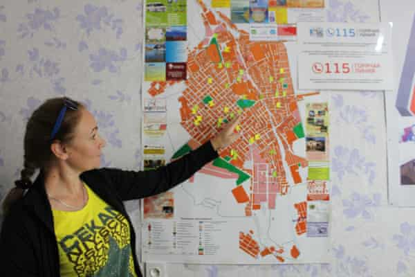 A sex worker rights defender in Karakol, Kyrgyzstan shows Front Line Defenders a map of brothels in the city where activists conduct outreach to at-risk sex workers
