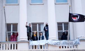 Members of the Autonomous Nation of Anarchist Libertarians on the balcony of the Eaton Square property.