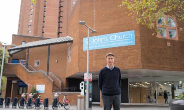 The Rev Paul Dawson, vicar of St Andrew's, photographed outside St John's across the street