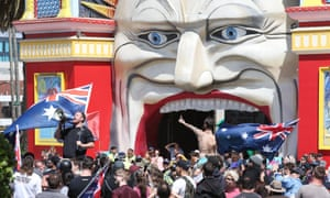 Rally at St Kilda beach: far-right activists protest in front of Luna park fun fair in Melbourne on Saturday.