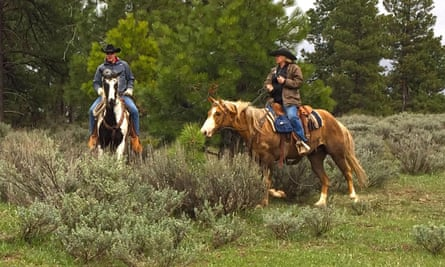 US Secretary of the Interior, Ryan Zinke, left, takes a horse ride with local ranchers during a tour of the Bears Ears National Monument in May 2017.