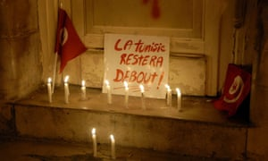 Placard reads 'Tunisia will remain standing' during a rally after an attack on the Bardo museum in Tunis.