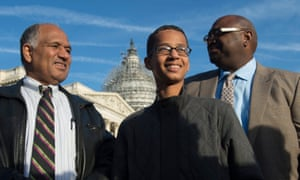 Ahmed Mohamed, centre, is flanked by his father, Mohamed Elhassan Mohamed, left, and spokesperson Ron Price, right, at an event in Washington on Tuesday.