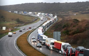 Lorries queue on the A20 in Kent as ferry services at The Port of Dover are effected by stormy weather