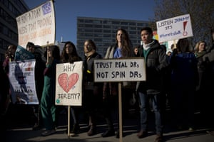 London, England: Junior doctors hold placards