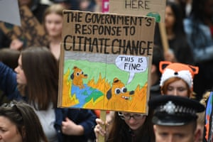 Supporters carry placards as they march during the YouthStrike4Climate demonstration