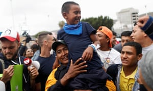 A man and his son, members of the caravan of migrants from Central America, near the San Ysidro checkpoint on 30 April.