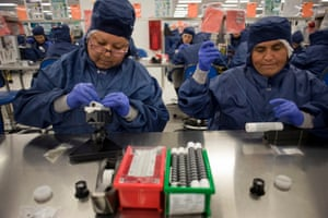 Employees work on stent graft components at an assembly plant in Tijuana, Mexico.