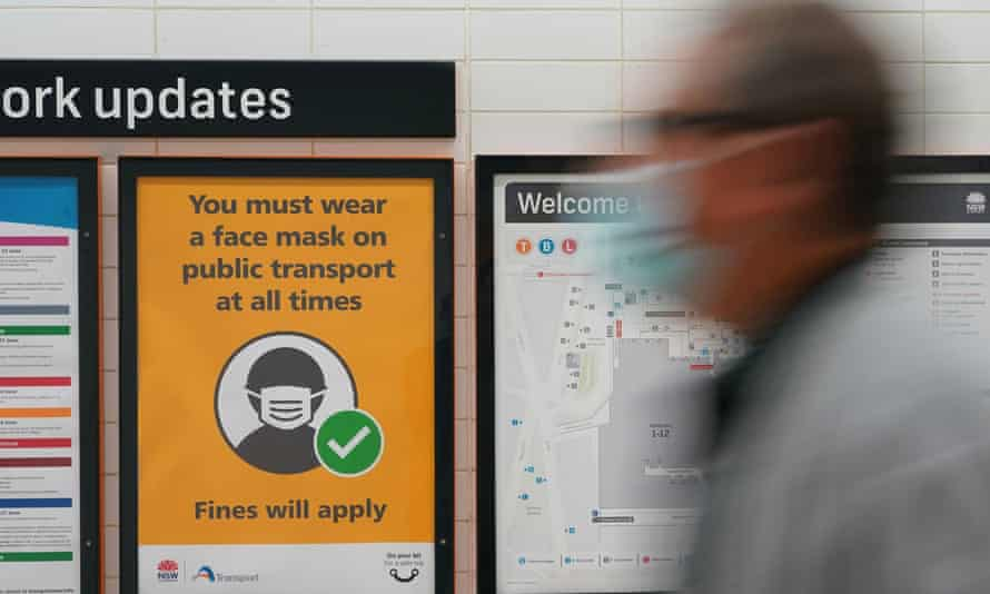 A sign at Central Station on Wednesday mandates mask-wearing on public transport as greater Sydney battles a Covid outbreak. Laboratory studies have found particles of the virus can linger in the air in aerosolised form for up to 16 hours.