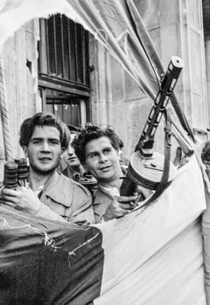A close-up of rebels through the cutout Hungarian flag