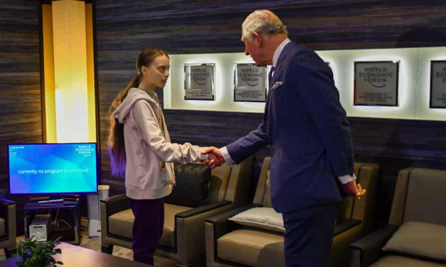 Prince Charles shakes hands with the climate activist Greta Thunberg in Davos.