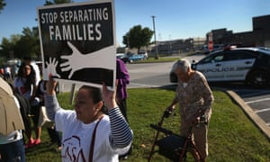 US immigration reform activists, including family members of detained undocumented immigrants, protesting in Pennsylvania this week.
