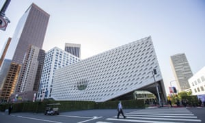 A person crosses the street by The Broad Museum prior to a dinner gala in Los Angeles, California September 17, 2015. The new museum built by philanthropists Eli and Edythe Broad, featuring their collection of modern art, will open to the public on September 20. REUTERS/Mario Anzuoni