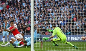 Alexis Sanchez, left, scores Arsenal's second goal in their FA Cup semi-final defeat of Manchester City last season.