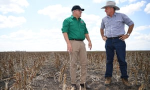 Scott Morrison chats to farmer David Gooding on his drought-affected property near Dalby, Queensland, 27 September 2019