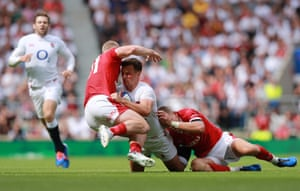 George Ford of England is tackled by Liam Williams (R) and Aled Davies of Wales.