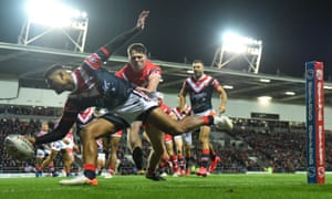 Daniel Tupou scores the first Sydney Roosters try against St Helens.