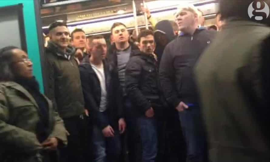 Still from the Guardian video that shows Chelsea fans preventing a black man from boarding a metro train in Paris
