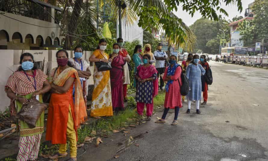 Women wear masks in Kochi, Kerala state. The state had been praised for its initial response to the virus.
