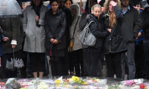 People near the scene of the recent attack observe a minute's silence in tribute to the victims of the attack at London Bridge and Borough Market