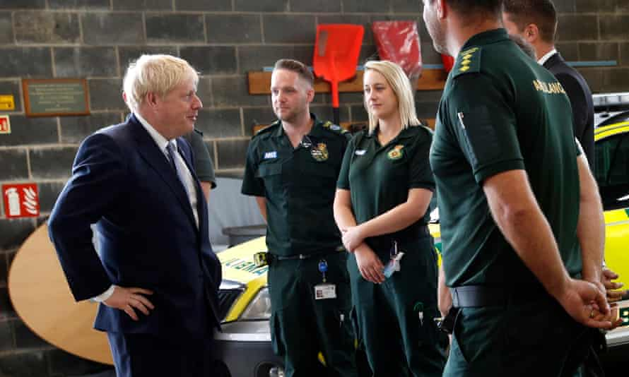 Boris Johnson chats with NHS ambulance crews during a visit to Pilgrim hospital in Boston, Lincolnshire