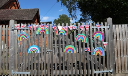 flags and rainbows on closed school gate