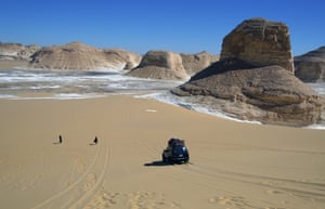Desert safari vehicles drive in the Aqabat desert near the Farafra oasis