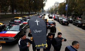 Taxi drivers in Santiago, Chile carry a fake coffin to protest against Uber. Now the public sector is being courted by the tech firm's promise of more efficient services.