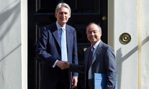 Philip Hammond and Masayoshi Son outside No 11 Downing Street