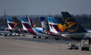 Airplanes of the leisure airlines Eurowings and Condor parked on the tarmac in Düsseldorf.