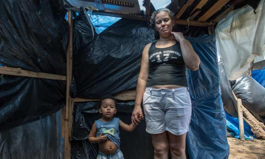 A woman with her son in a tent under construction
