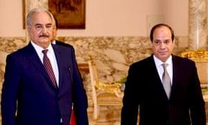 Egypt's president, Abdel Fatah al-Sisi, right, meeting the Libyan warlord Khalifa Haftar, left, in Cairo