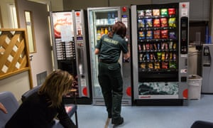 Medical staff at a hospital vending machine.