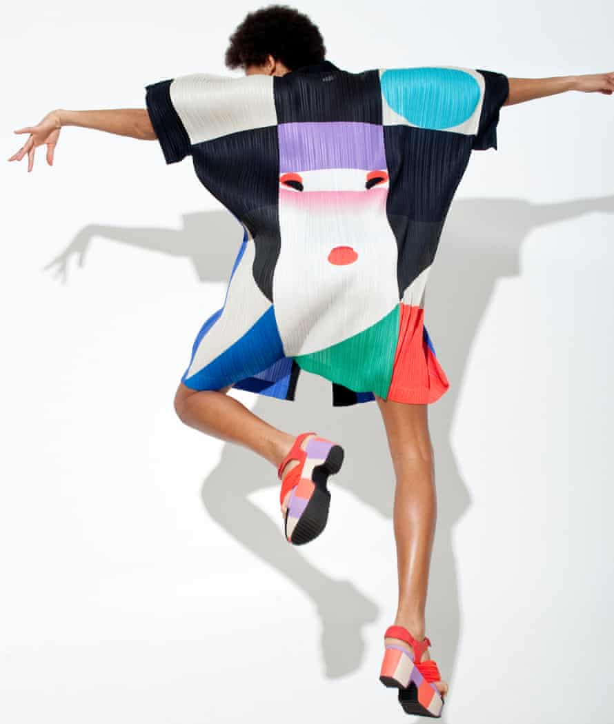 A multi-coloured square-shaped Issey Miyake top on a dancing woman