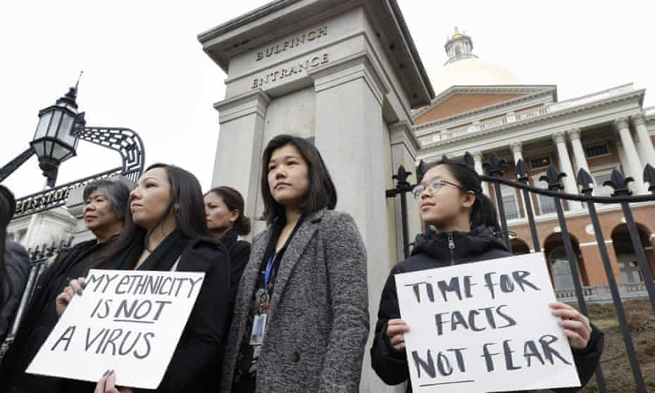 Members of the Massachusetts's Asian American Commission protest racism aimed at Asian communities amid the coronavirus pandemic at the statehouse in Boston.