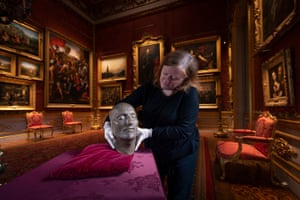 London, UK. The keeper of the Wellington Collection, Josephine Oxley, prepares the death mask of Napoleon Bonaparte for display at Apsley House on the 200th anniversary of the French leader's death