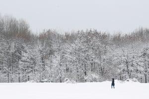 Sofia, Bulgaria: A woman walks in a snowy park