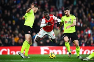 Nicolas Pepe of Arsenal is tackled by Enda Stevens of Sheffield United during their 1-1 draw at the Emirates. John Fleck's late equaliser for the Blades ensured they remain four point clear of the Gunners.