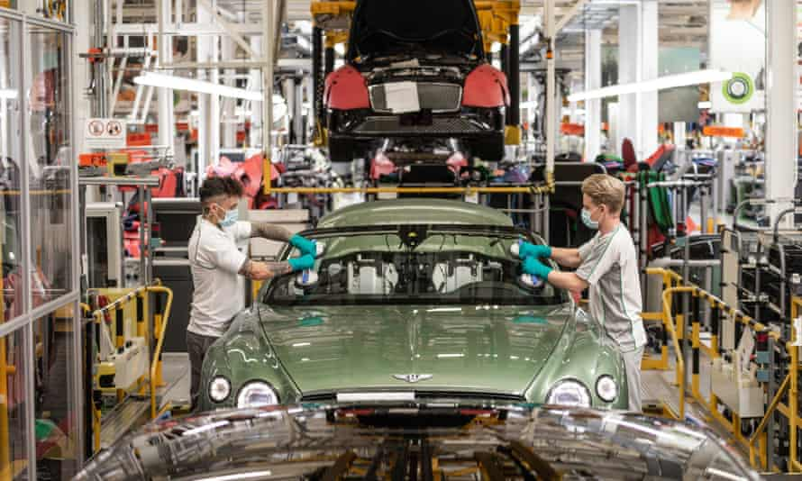 Two workers at the Bentley factory in Crewe