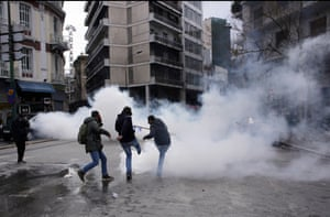 Riot police use teargas to repel the protesters