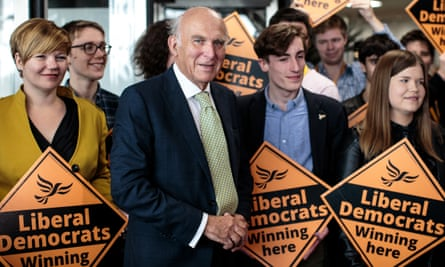 Liberal Democrat Leader Vince Cable poses for pictures as he arrives ahead of his speech at the Liberal Democrat Party Conference at the Brighton Centre on September 18