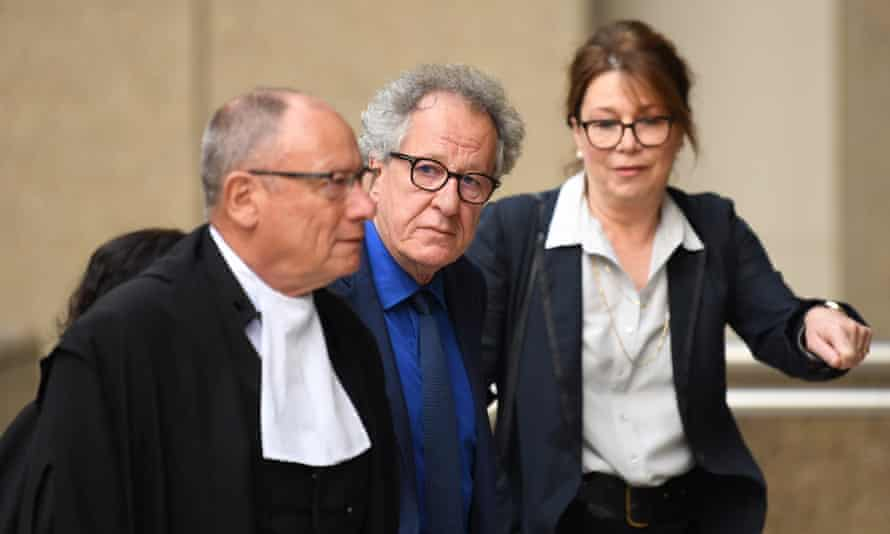 Actor Geoffrey Rush (centre) arrives to give evidence in his defamation trial at the federal court in Sydney on Monday.