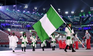 Flag bearer Ngozi Onwumere of Nigeria and teammates enter the stadium.