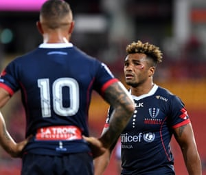 Will Genia of the Rebels (right) chats to teammate Quade Cooper during the Round 7 Super Rugby match between the Queensland Reds and the Melbourne Rebels at Suncorp Stadium in Brisbane.