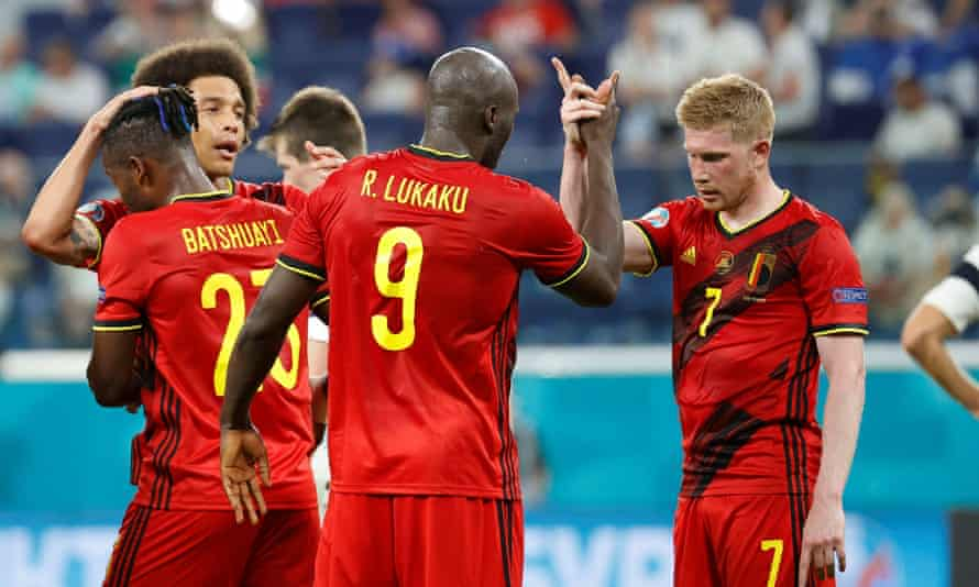 Belgium's Romelu Lukaku and Kevin De Bruyne try to calculate how they won their group and ended up playing Portugal.